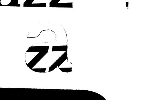 Close-up de la construction typographique, contours vibrants